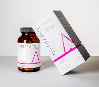 Nutrafol product for women. Pills in a bottle.